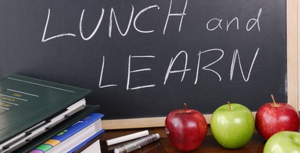 Lunch and Learn written on board with apples in-front of it